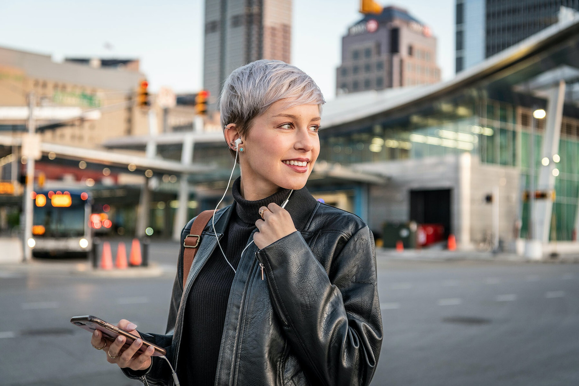 Klipsch wired headphones woman in a city music consumption