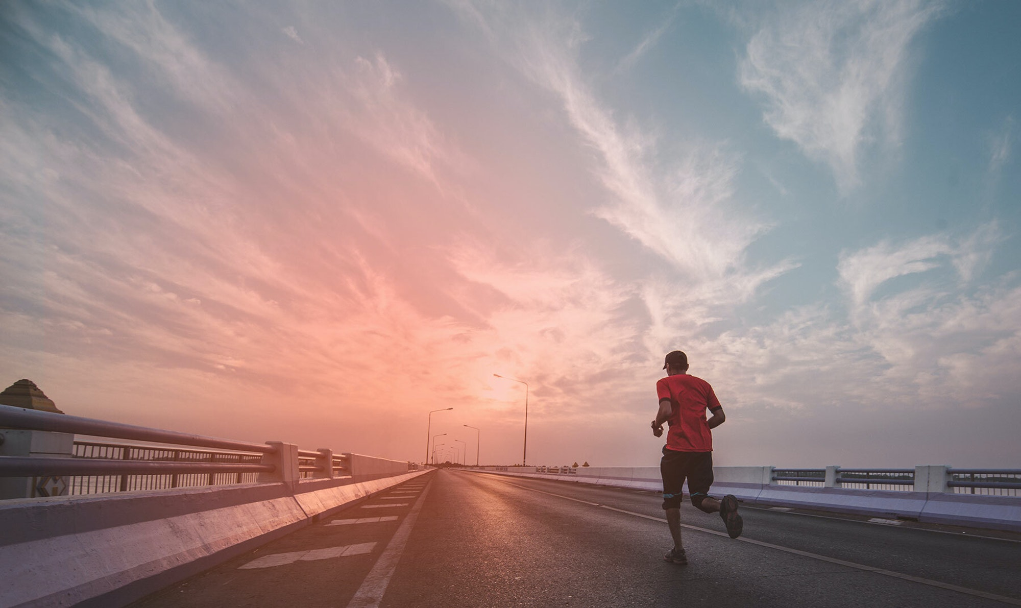 Man running with sport earbuds