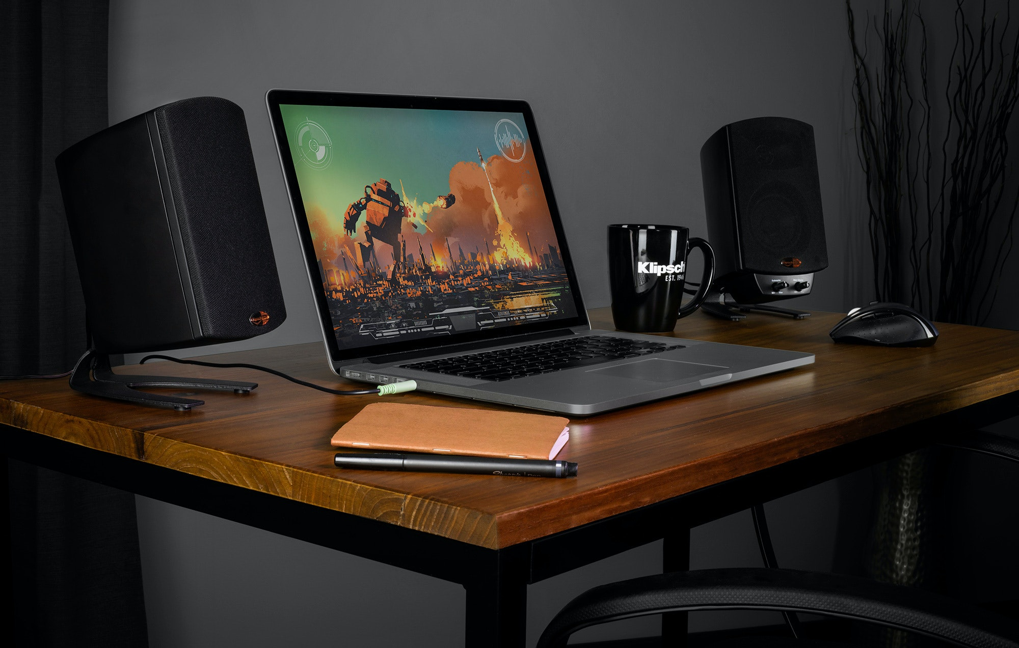 ProMedia 2.1 THX Computer speakers flanking a laptop on a desk
