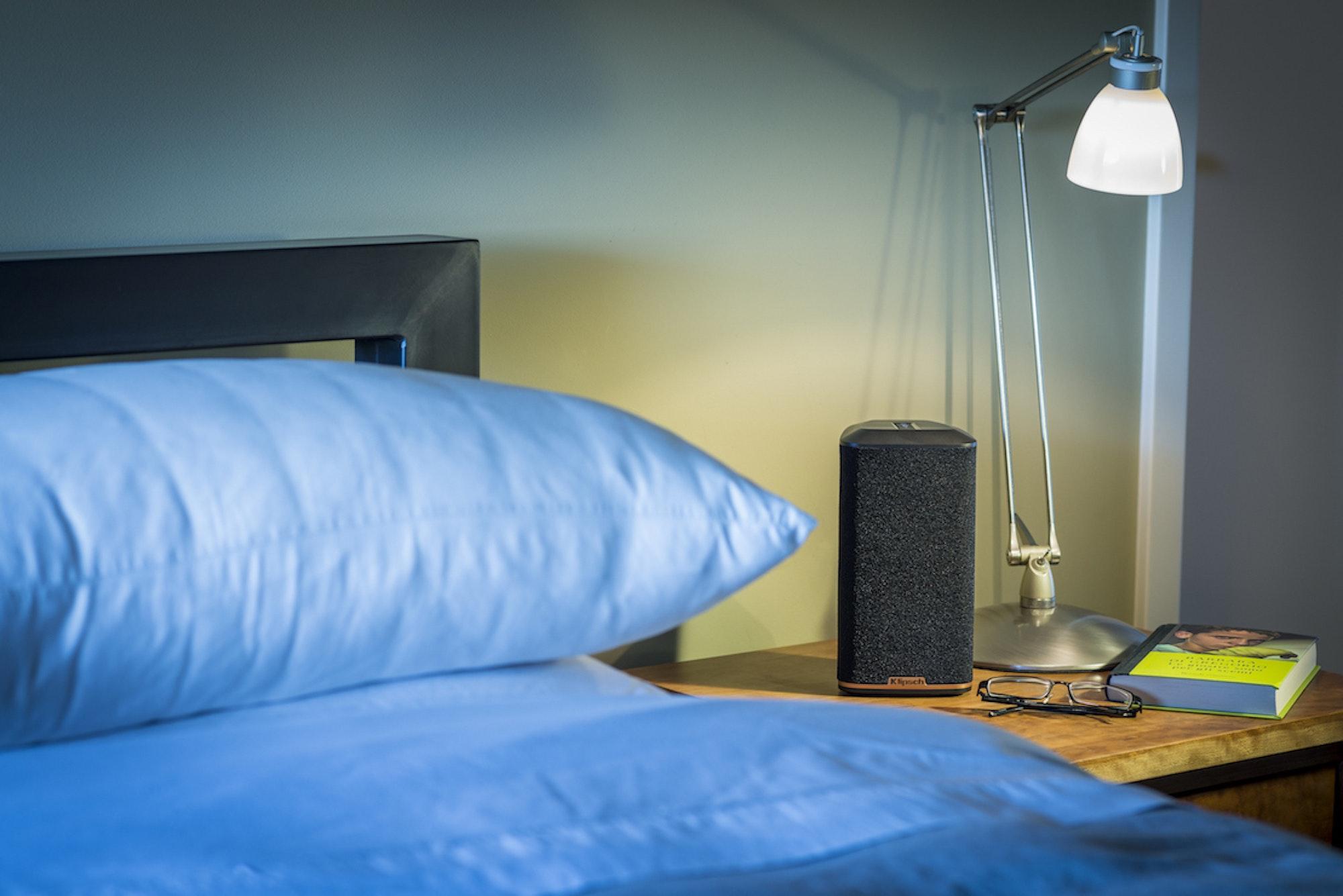 RW-1 wireless speaker on a bedside nightstand
