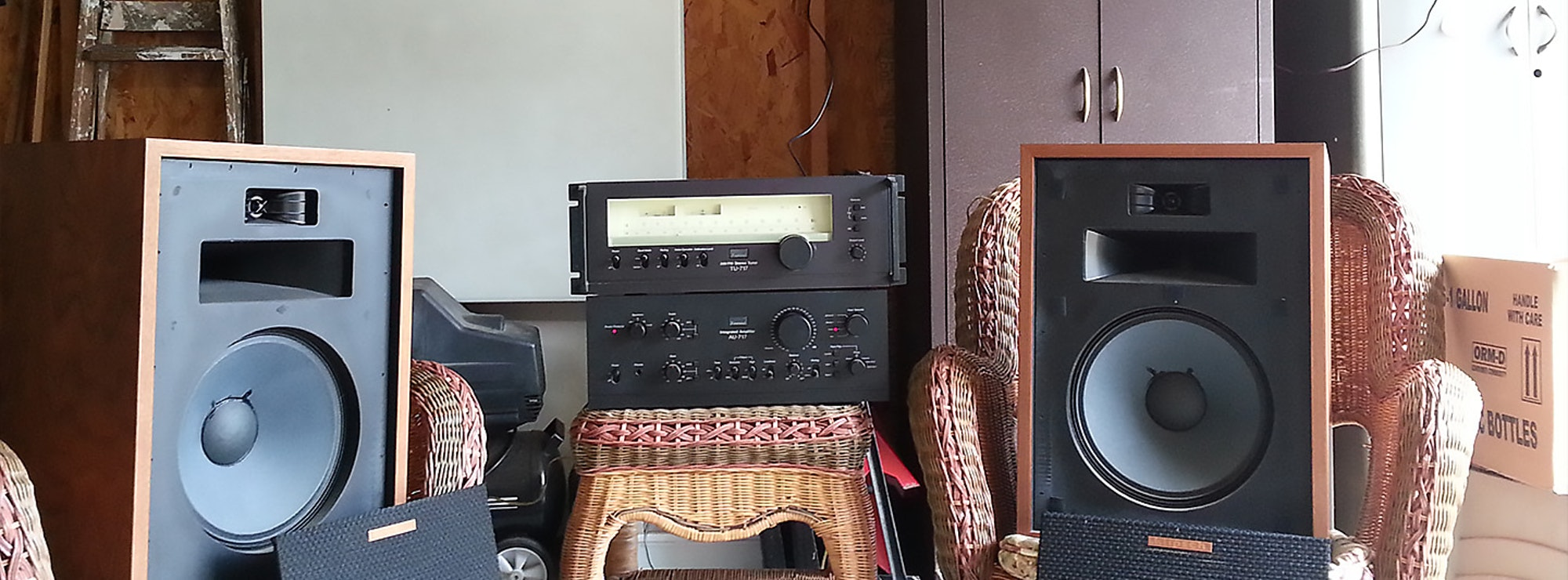 Two Heresy speakers in a garage