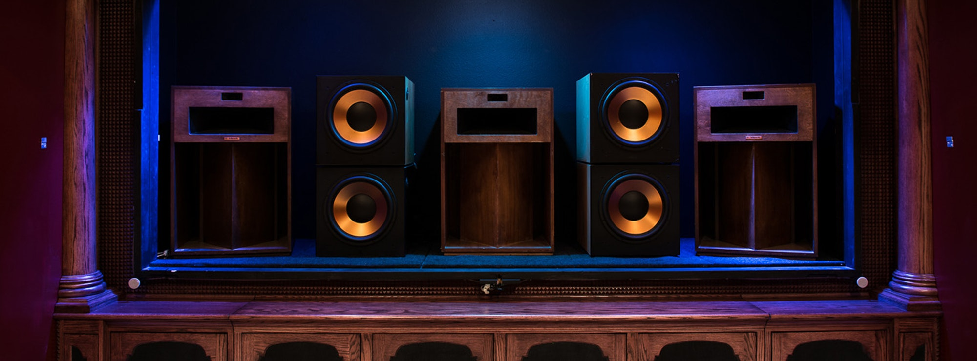 3 La Scala speakers and 4 RSW-15 subwoofers behind a home theater screen