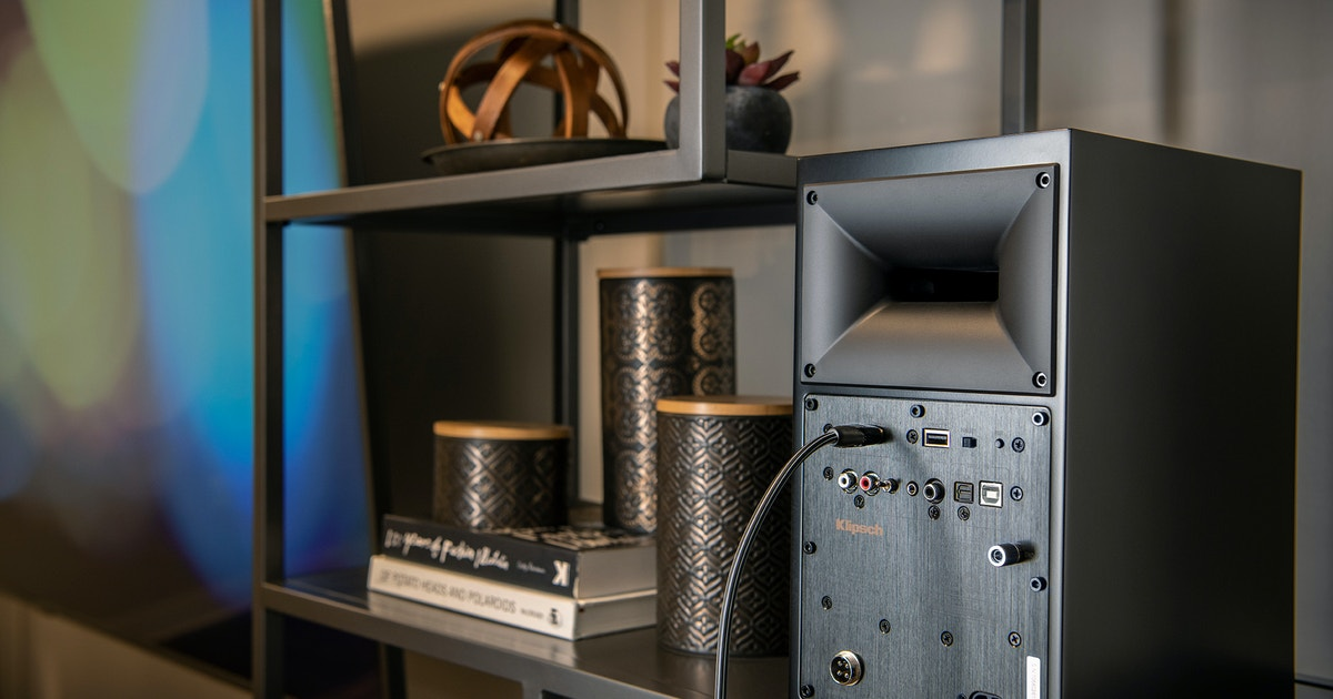 Backview of Klipsch the Fives speaker being connected to an audio source