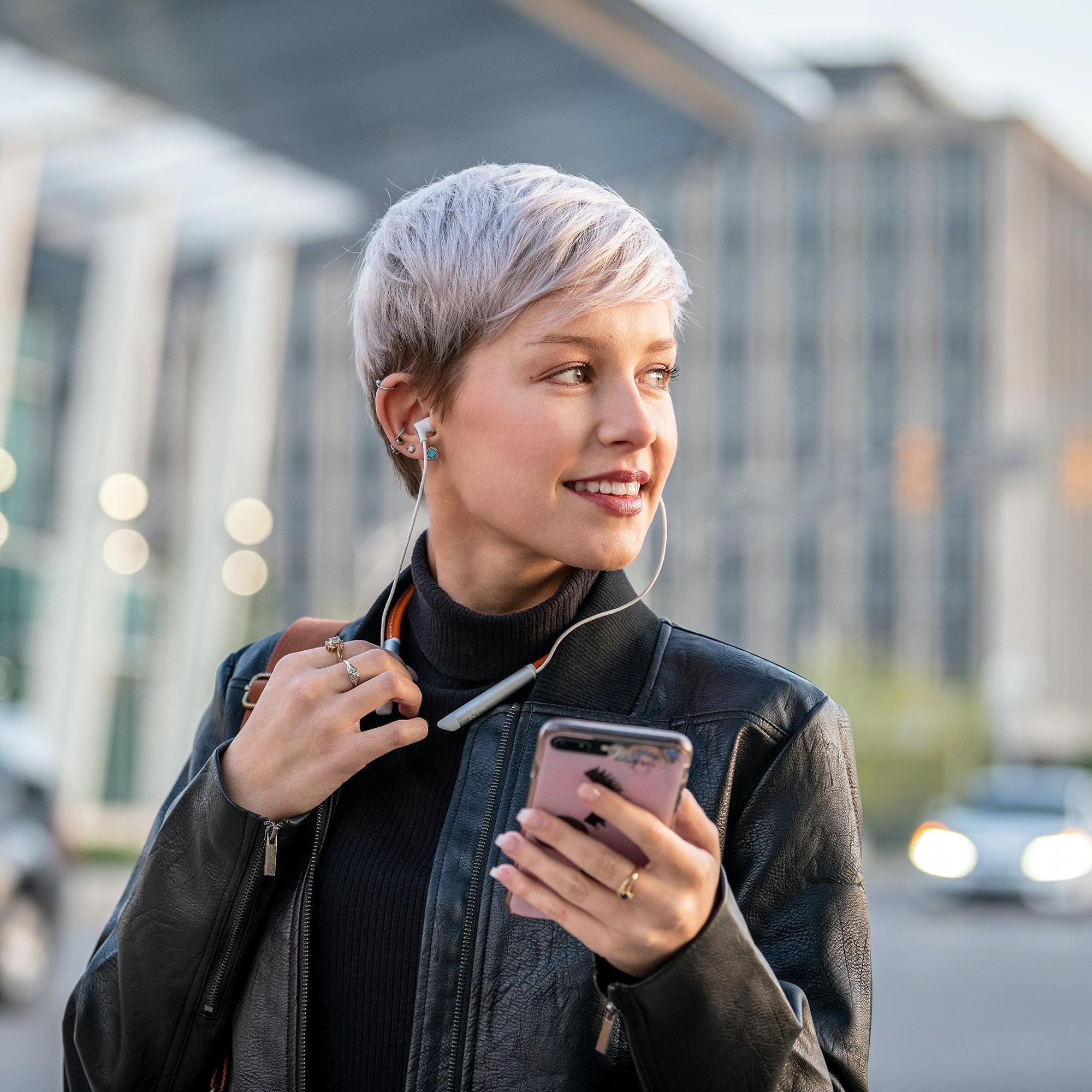 Woman wearing Klipsch T5 neckband earphones