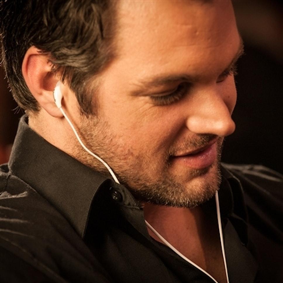 Man listening to Klipsch X7i in-ear headphones