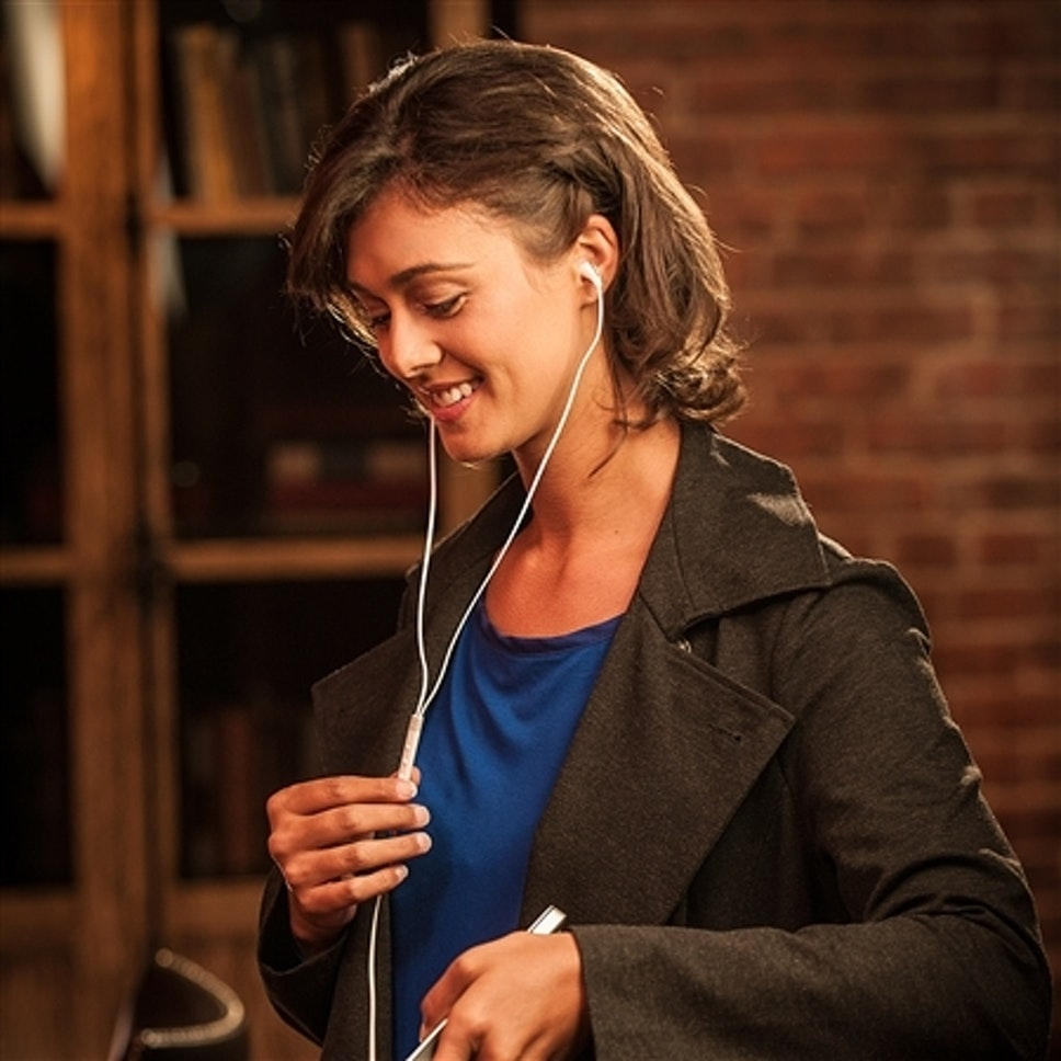 Woman listening to Klipsch X7i in-ear headphones