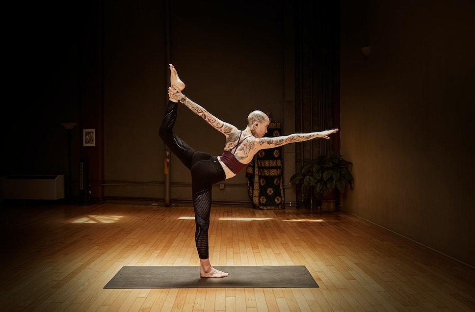 Girl listening to T5 True Wireless earphones while doing yoga
