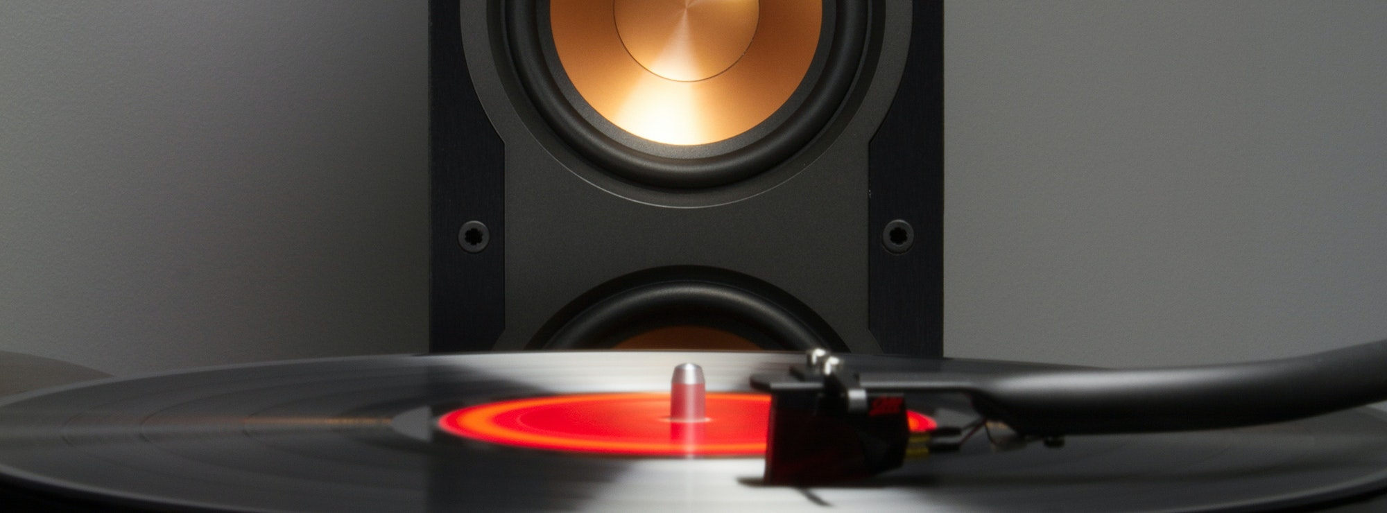 record on turntable in front of Klipsch speaker